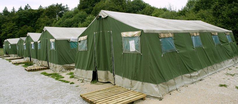 Green tent camp in Pyrenees for  Santiago pilgrims