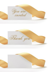 golden ribbon and greeting card on a white background