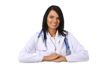 Smiling young doctor with blank sign