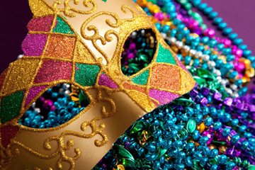 Wall Mural - Gold mardi gras mask and beads