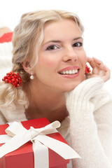 Happy blond girl with gift over white