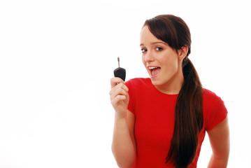 Happy girl holding car key