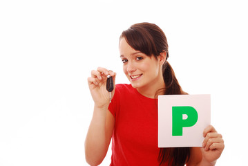Girl holding car key and P plate