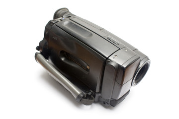 Old handy camera isolated in white background