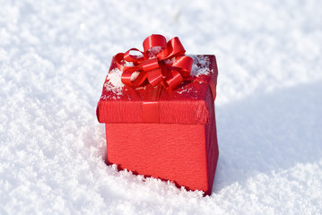 Red gift box on snow