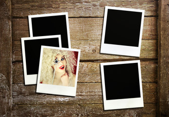 Retro photo frames on wood