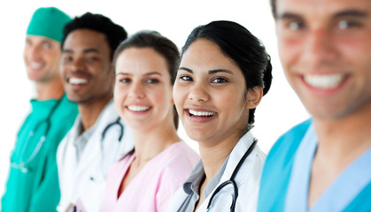 A diverse medical group standing in a line