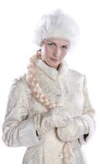 Beautiful girl in a white winter coat