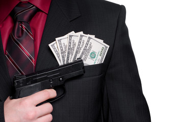 Businessman with gun and money. Isolated on white