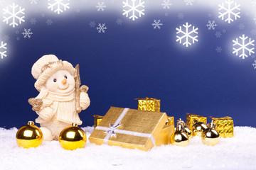 snowman figure and golden ornaments