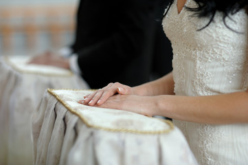 Bride's hands close-up during church ceremony
