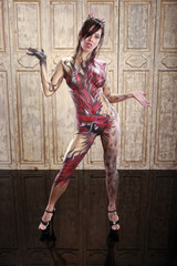 Cute asian girl in red dragon bodypainting