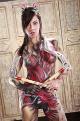 Dragon bodypainting asian girl with Kama axes