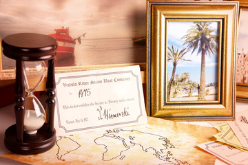 Travel objects. Old tickets, frames, map, picture and hourglass.
