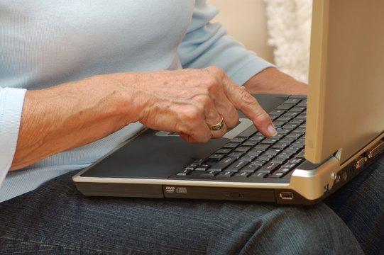 Elderly hand with notebook