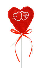 Valentines heart on a stick with red and white ribbons, isolated