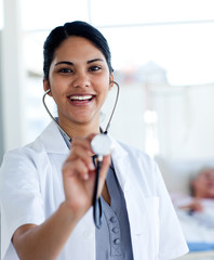 Female doctor holding a stethoscope