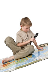 Cute little boy learn a map of the world isolated on white.