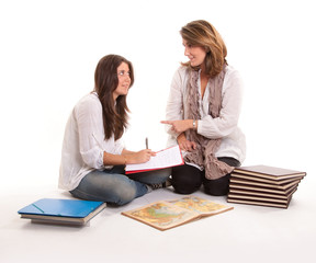 Mother and teenage daughter at homework