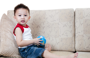 Asian boy with toy.