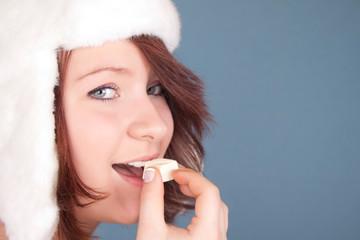 portrait of girl biting white chocolate