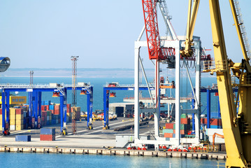 The trading seaport with cranes, cargoes and ship