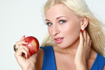 Beautiful sexy blonde with red apple
