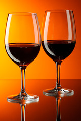 Two glasses of red wine.