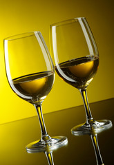 Two glasses of white wine.