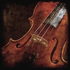 beautiful vintage violin over dark background