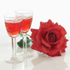 two glasses and rose