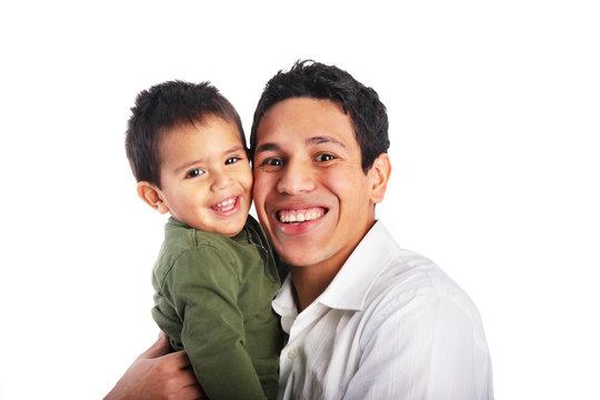 Dad hugging toddler son smiling