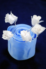 The White flowerses and blue tape.