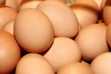 a closeup of a pile of brown eggs