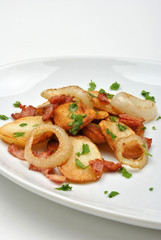 roasted potato with organic onion on a plate