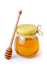Honey jar with honeycomb lid and wooden spoon