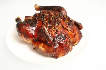 Oven baked teriyaki apple chicken isolated on white.