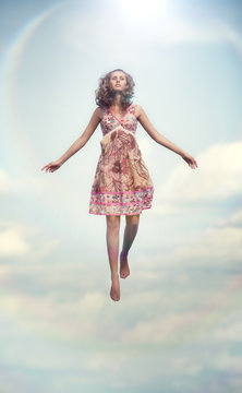 Young woman flying up