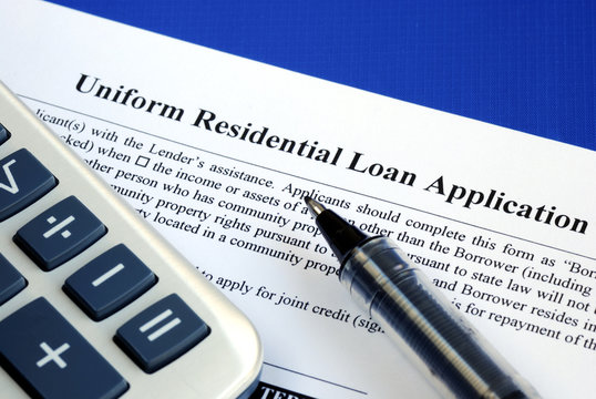 File the mortgage application isolated on blue