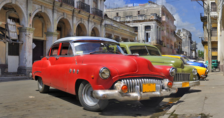 Photo on textile frame Old cars Havana street with colorful old cars in a raw