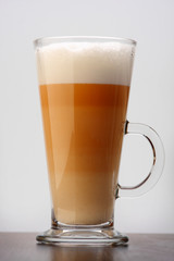 Coffee Latte in a tall glass on dark background