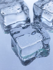 Ice cubes on the cool background. Abstract