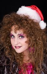 Beautiful curly-headed Santa-girl