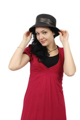 GIRL WITH HAT AND RED DRESS SMILING ON WHITE