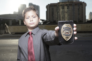 Child detective showing his badge