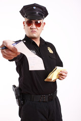 A male police officer giving a citation.