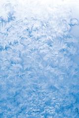 Light blue frozen window glass