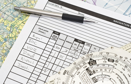 A nvavigation log and an E6B flight computer