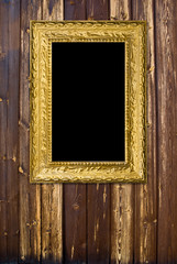 Grunge wood background with vintage gold frame