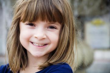 Portrait of a pretty happy little girl